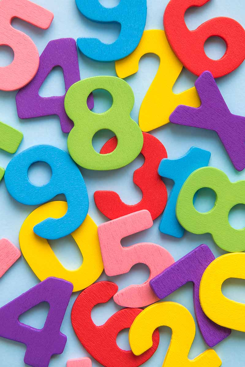Assorted colorful numbers on a blue table