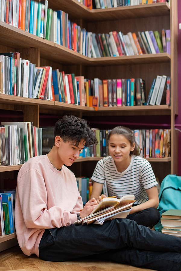 Students in library reading