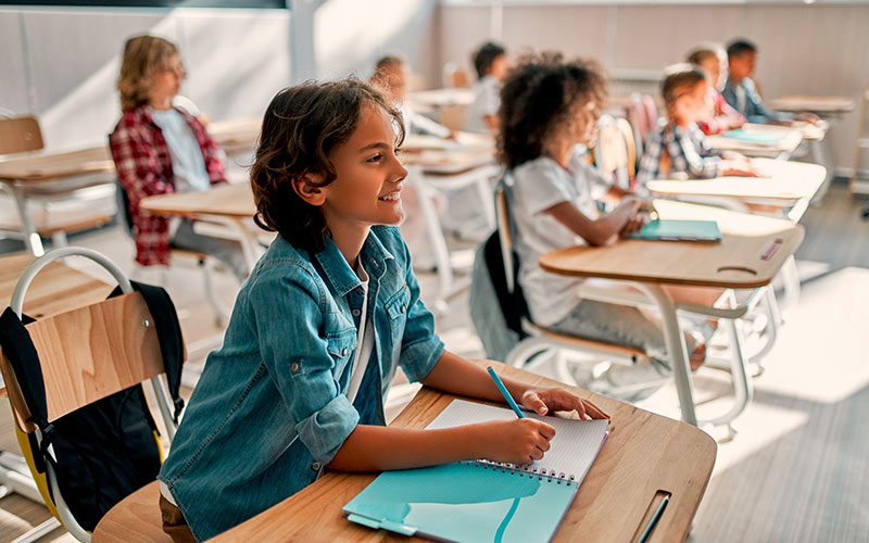Student smiling while in classroom
