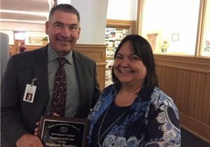 Greg Lynch and Stephanie Doebbler holding plaque